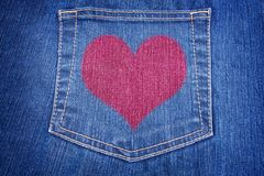 Blue jeans pocket with red heart Royalty Free Stock Images
