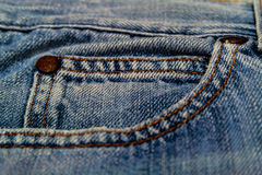 Blue jeans pocket. Blue jeans texture with close-up pocket and button Royalty Free Stock Photos