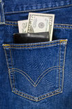 Blue jeans pocket with wallet and dollars Stock Photos