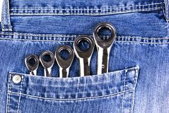 Blue jeans pocket with wrenches Stock Images