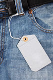 Blue jeans with price tag. Photo shot of blue jeans with price tag Stock Image