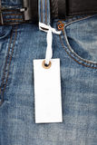 Blue jeans with price tag. Photo shot of blue jeans with price tag Royalty Free Stock Image