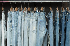 Blue jeans on rack Stock Photos
