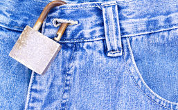 Blue jeans with rusty padlock Royalty Free Stock Photos