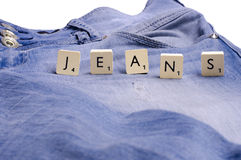 Blue jeans. With scrabble stock photography