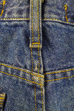 Blue jeans with seam, denim texture background, close up. Blue jeans with seam, denim texture background, close up stock photo
