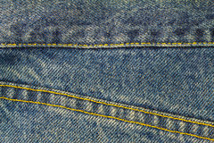 Blue jeans with seam, denim texture background, close up. Royalty Free Stock Image
