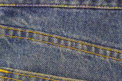 Blue jeans with seam, denim texture background, close up. Stock Photo
