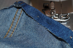 Blue Jeans Sewing Stock Photo