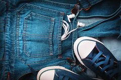Blue jeans and sneakers Stock Photo