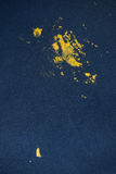 Blue Jeans and sneakers stained with yellow paint. Stock Photos