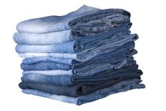 Blue jeans stack. Front view of stack, blue denim jeans stock photo