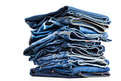 Blue jeans. Stack of blue jeans on white Stock Images