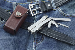 Blue jeans with stainless multitool knife Royalty Free Stock Images