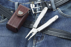 Blue jeans with stainless multitool knife Stock Photography