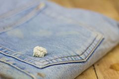Blue jeans stick with white color chewing gum stock photo