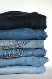 Blue jeans on stock. Some pairs of jeans on the table Stock Image