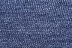 Blue jeans structure and texture for background. Stock Photo