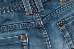 Blue Jeans-strukturierter Hintergrund mit Stichen Stockbilder