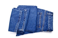 Blue jeans su una priorità bassa bianca Immagini Stock Libere da Diritti