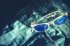 Blue jeans and sun glasses Stock Photos