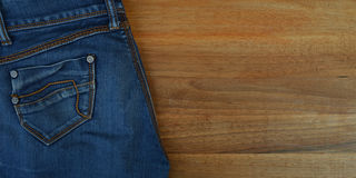 Blue jeans on the table Stock Photo