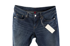 Blue jeans with tag Stock Photography