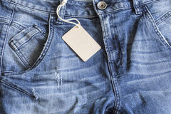 Blue jeans with tag on close up. Blue jeans with tag  on close up Royalty Free Stock Photos