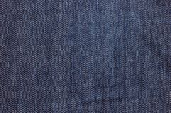 Blue jeans texture stock images