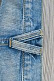 Blue jeans texture back side. Part of denim jeans with seams on wooden background, vertical image royalty free stock photos
