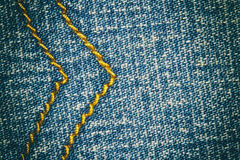 Blue jeans texture background and seam for text area Royalty Free Stock Images