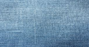 Blue jeans. jeans texture or denim jeans background with old torn. Pockets of jeans. Stock Image