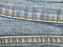 Blue jeans texture with seams background Royalty Free Stock Image