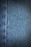 Blue jeans texture, vignetted background Stock Images