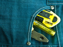 Blue jeans and tools Stock Images