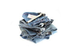Blue Jeans,Tools and money Placing stacked. Royalty Free Stock Images