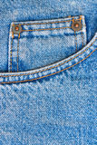 Blue jeans trousers pocket as background. Worn blue denim jeans trousers pocket as texture or background to insert text or design Stock Photo