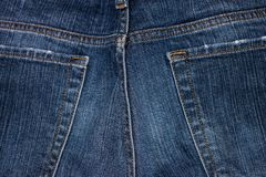 Blue jeans trousers and texture. Texture of a blue jeans trousers not treated in any way royalty free stock photography