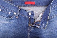 Blue Jeans und Fliege Stockbild