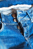 Blue jeans with unfasten buttons closeup Stock Photo