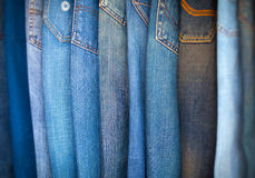 Blue-Jeans in Various Shades of Blue, Arranged on Display. Royalty Free Stock Photos