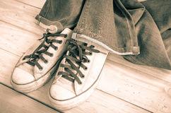 Blue jeans and vintage sneakers. Stock Image