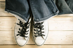 Blue jeans and vintage sneakers. Royalty Free Stock Photos