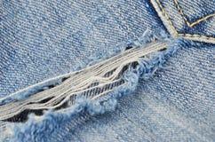 Blue jeans violente fotografie stock
