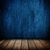 Blue jeans wall and wooden floor interior Royalty Free Stock Images