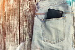 Blue jeans with a wallet in the pocket Royalty Free Stock Images