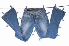 Blue jeans on washing line Royalty Free Stock Photos