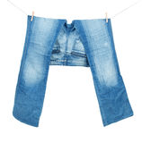 Blue jeans on washing line Stock Image