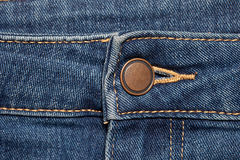 Blue Jeans wavy with Button Stock Image