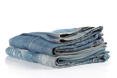 Blue jeans on a white background Royalty Free Stock Photos